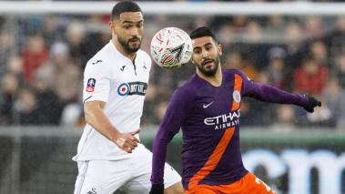 Cameron Carter-Vickers of Swansea City challenges Riyad Mahrez of Manchester City during the English Emirates FA Cup match at the Liberty Stadium, Swansea, Wales, Britain, 16 March 2019. EFE